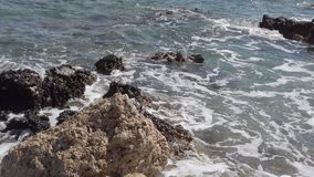 Waves On Rocks Coast of the Mediterranean Sea in Rhodes. stock footage