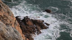 Waves and Rocks. Waves crushing the rocks from Brittany near the cape Pointe de Pen-Hir in Finistere on the western France coast stock video