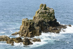 Waves on rocks at Land End, Cornwall Stock Images