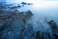 Waves and rocks, long exposure Stock Photo