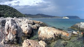 Waves and rocks. Waves of the Mediterranean Sea, rocks, mountains at sunset stock video footage
