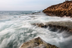 Waves and rocks Stock Images
