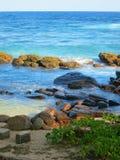 Waves and rocks at ocean bay in Sri-Lanka Royalty Free Stock Images