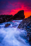 Waves and rocks in the Pacific Ocean at sunset, at Woods Cove  Stock Photography