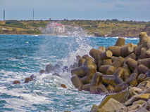 Waves and rocks on the quay Royalty Free Stock Photo