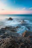 Waves and rocks shore long exposure Royalty Free Stock Image