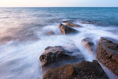 Waves and rocks shore long exposure Stock Photos