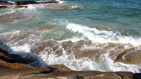 Waves on rocks. Waves splashing on sea shore stock footage
