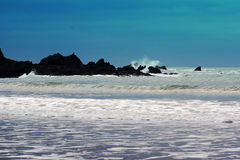 Waves, rocks and spray Royalty Free Stock Image