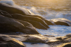 Waves on rocks Stock Photography