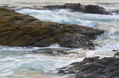 Waves on rocks Royalty Free Stock Photo