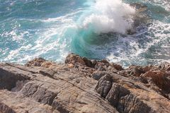 Waves and rocks in winter. Sea waves and rocks in winter Royalty Free Stock Image