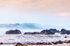 Waves at rocky shore Royalty Free Stock Image