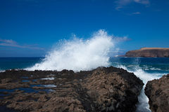 Waves by the rocky shore Stock Image