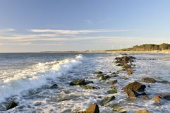 Waves on rocky shoreline Stock Photos