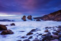 Waves on rocky shores at dawn