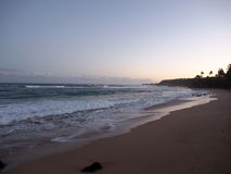 Waves roll into shore at day break on the North Shore beach. On Oahu, Hawaii Stock Photo