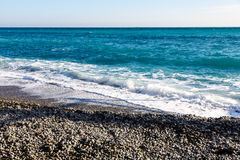 The waves rolled onto the beach of pebbles.  Royalty Free Stock Photo