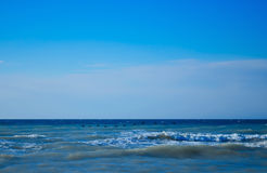Waves rolled on the rocky coast Royalty Free Stock Photo
