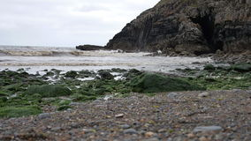 Waves rolling in along the shore of North Wales stock video footage