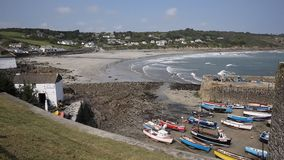 Waves rolling in and Cornish harbour of Coverack Cornwall England UK coastal fishing village on the Lizard Heritage coast Royalty Free Stock Photos