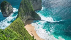 Waves rolling on Manta Bay or Kelingking Beach on Nusa Penida Island, Bali, Indonesia