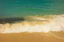 Waves rolling onto a beach in the caribbean Stock Image