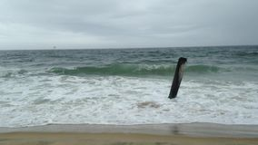 Waves rolling onto beach stock footage