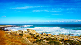 Waves rolling on to the shoreline of the Atlantic Ocean coast at Cape of Good Hope Royalty Free Stock Photo