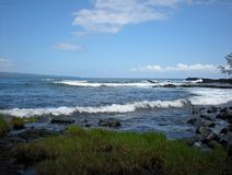 Waves Rolling Towards the Lava Shoreline and Green Grasses. Big Island, Hilo, Hawaii Stock Photo