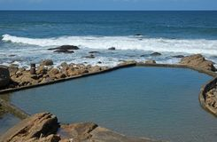Waves rolling towards tidal pool at Ramsgate, Kwazulu Natal. Waves rolling over rocks towards calm tidal pool at Ramsgate, Kwazulu Natal Royalty Free Stock Image