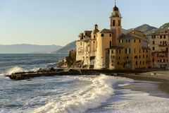 Waves of rough sea  shuttering in front of apse of Assunta churc Royalty Free Stock Photography