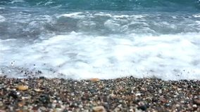 Waves rush onto the beach stock footage