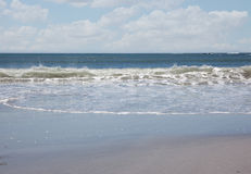 Waves rushing in from ocean Royalty Free Stock Photo