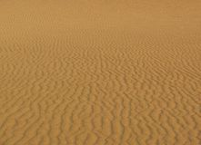 Waves in the sand Stock Photography