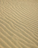 Waves on the Sand. Diagonal sand waves at the beach royalty free stock images