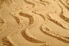 Waves in the sand background Stock Photos