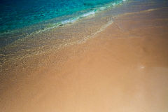 Waves & Sand Background Royalty Free Stock Photography