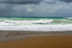 Waves On sand beach of the Aegean Sea in Rhodes. In summer day stock photography