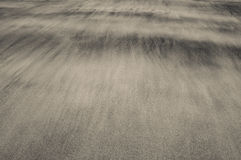 Waves of sand on a beach creating soft and delicate textures Stock Photo