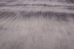Waves of sand on a beach creating soft and delicate textures Royalty Free Stock Images