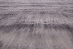 Waves of sand on a beach creating soft and delicate textures Royalty Free Stock Photos