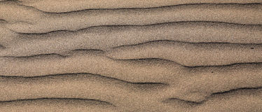 Waves of sand on the beach high contrast color gradient, background Royalty Free Stock Images