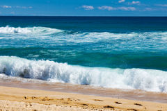 Waves on sand beach Stock Photos
