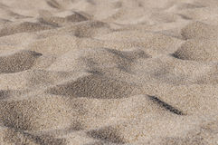 Waves of sand. On the deserted beach closeup stock photos