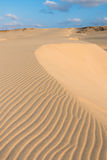 Waves on sand dunes  in Chaves beach Praia de Chaves in Boavist Royalty Free Stock Photos