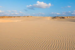 Waves on sand dunes  in Chaves beach Praia de Chaves in Boavist Royalty Free Stock Image