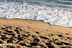 Waves on the sand royalty free stock photo