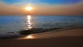 Waves on sand. Sunset stock video