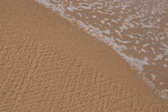 Waves on sandy beach Stock Image